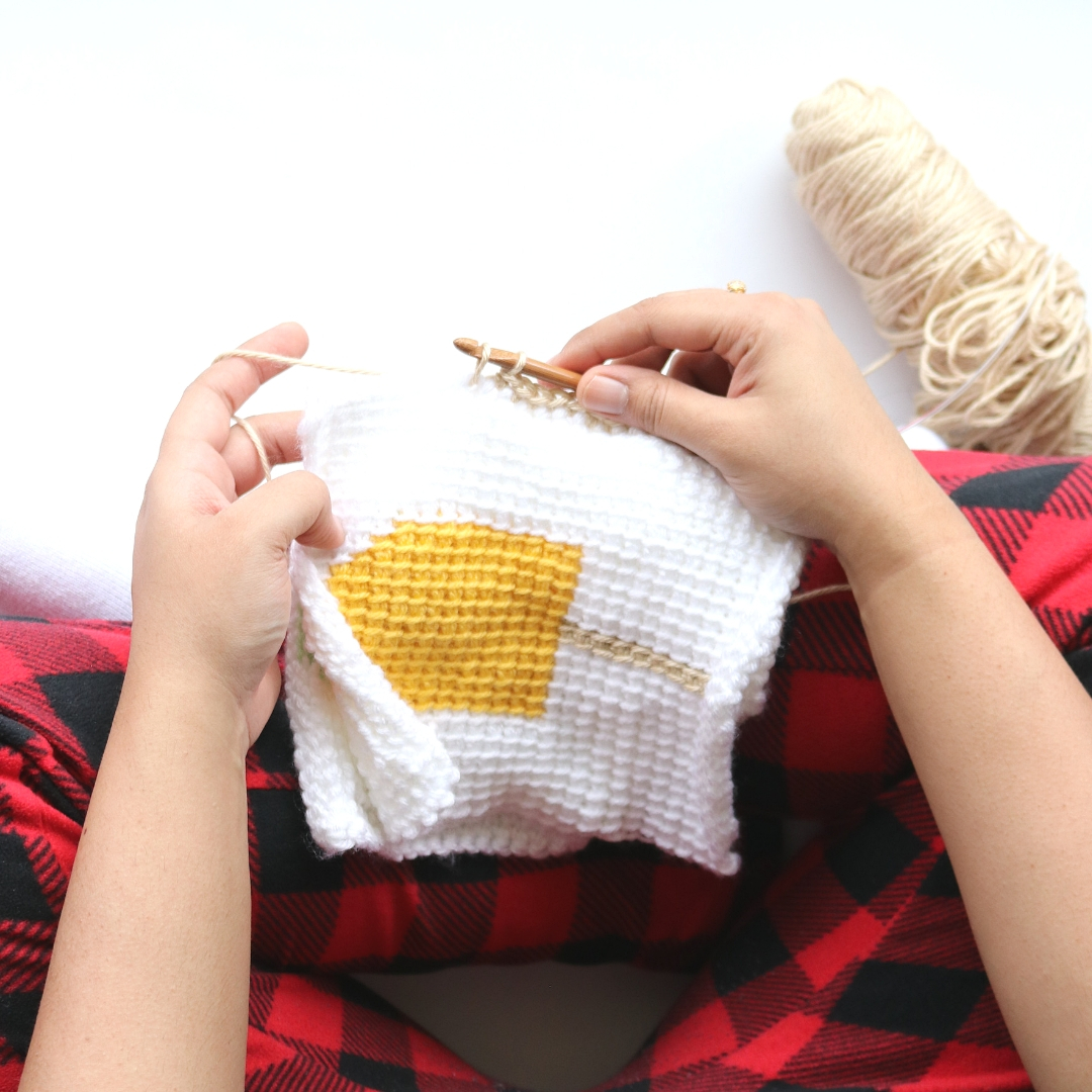 Joining the squares for the Creamsicle crochet baby blanket pattern.