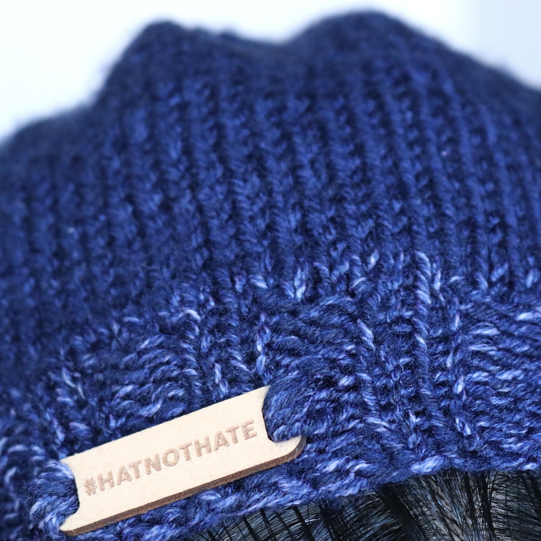 A close up of my #hatnothate hat