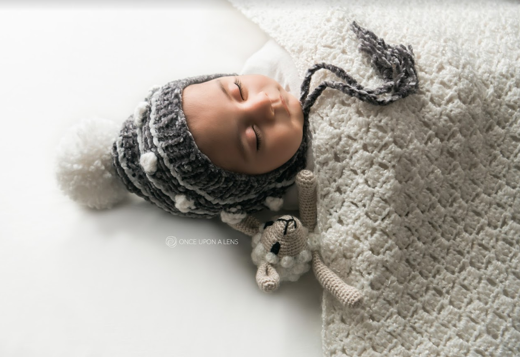 Looking for baby knitting patterns? Here is a luxurious baby bonnet knitting pattern perfect for a boy or girl! Check out this velvet Silver Lining Bonnet!