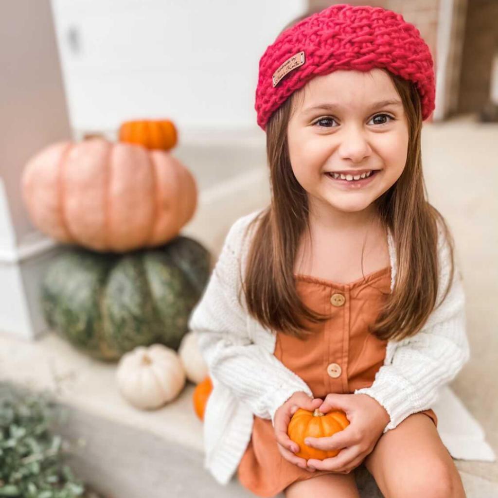 A beginner-friendly children's free crochet ear warmer pattern. It's Tunisian crochet,  can be made with a regular crochet hook.