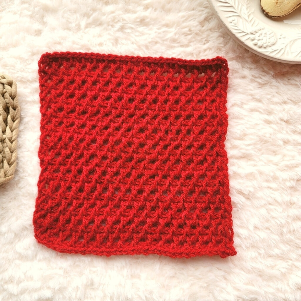 Looking to practice fun Tunisian crochet stitches. Check out this FREE Tunisian Arrowhead Square crochet blanket square pattern!